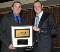 Buffalo Run Golf Course Assistant Professional Jared Butler (left) displays his PGA award with an official from the Colorado Section.