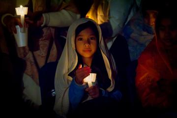 A young girl holds a candlelight vigil (photo (c) 2012 Dustie McIntyre & Journal Photography)