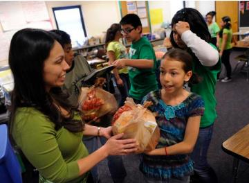 As part of a program developed by members of the Arvada Sunrise Rotary and the Food Bank of the Rockies, Columbian Elementary School students left received a small sack of groceries intended for use at home over the weekend.  Read more: Season to Share 20