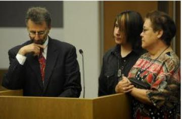 In this Oct. 19, 2010, file photo, 15-year-old Louis Pollack-Trujillo, center, appears in Denver's truancy court with his attorney, Robert Lubowitz, and his grandmother, Maria Trujillo. (RJ Sangosti, The Denver Post)  Read more: Truancy court as a la