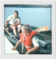 My dad & me pushing off from our pier in St. Germain.  The boat was wood and the lifejacket around my head might have saved my life but was more like a straight jacket when worn
